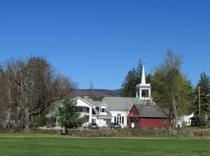 Village church and library in spring with blue sky